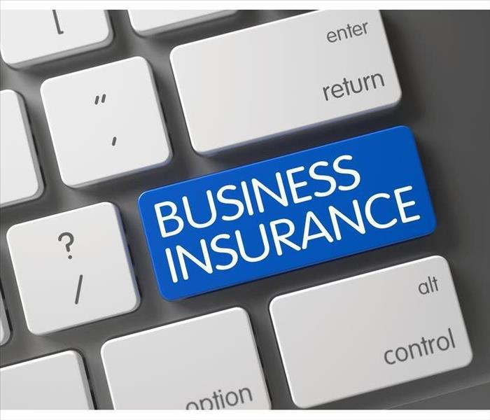 Concept of Business Insurance, with Business Insurance on Blue Enter Button on Modernized Keyboard.