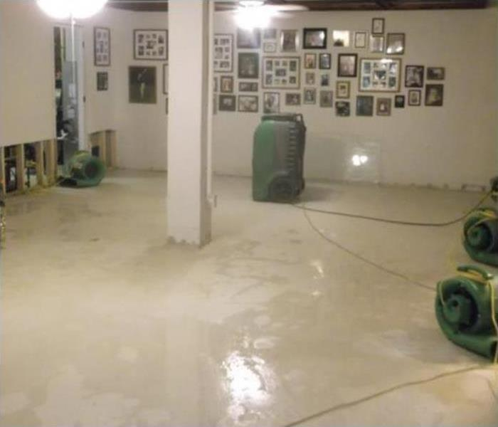 Air movers and dehumidifiers placed in a flooded home